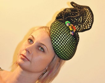Black and green structural millinery headpiece, racing fashion