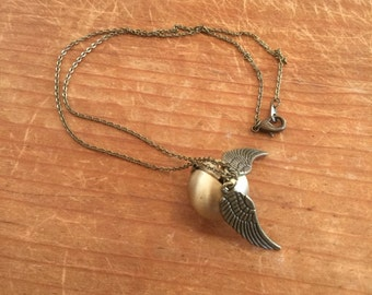 Harry Potter Inspired, Golden Snitch locket necklace, movie and book themed. Brass/Antique gold