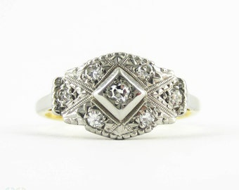 Art Deco Diamond Ring, Elongated Diamond Panel Ring in 18 Carat Gold & Platinum, Circa 1920s.