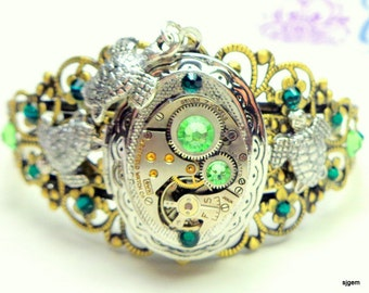 Steampunk Locket Bracelet,Sea Turtle Cuff,Ruby Jeweled Watch Movement,Green Swarovski Crystals,Neo Victorian,Vintage Style,Steam Punk Cuff