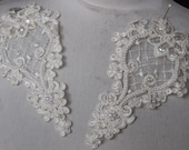 Cute embroidered  and beaded organza    applique ivory  color 2 pieces listing 6 inches long 3 1/4 inches wide at the widest part