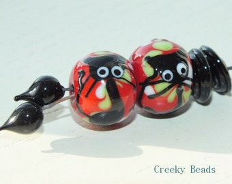 Handmade Lampwork beads, discs and headpins - Creeky Beads SRA