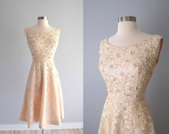 1950s dress / Blush Peach Satin & Lace fit and flare dress with sequins, pearls, and rhinestones...26 waist