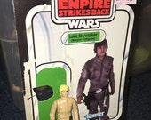 vintage Star wars Empire strikes back Luke Skywalker bespin fatigues action figure with weapon and card back