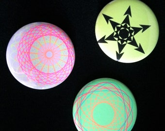 Neon Rainbow Geometrica – XL badge trio in Ultrafresh Green, Superhighlight Yellow, and Multi-Neon geometric patterns