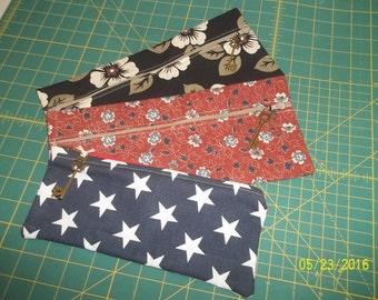 3 clutch purses