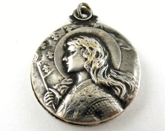 Antique French silver plated Joan of Arc slide locket