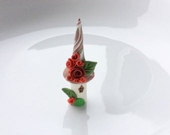 Miniature fairy house in brown, red and green handmade from polymer clay