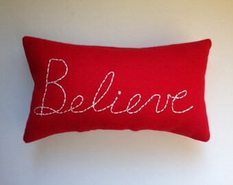 BELIEVE Old Red Wool Pillow for Instant Inspiration