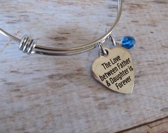 "Daughter Charm Bracelet- ""The love between Father & Daughter is forever"" laser etched charm with an accent bead in your choice of colors"