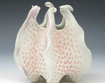 Porcelain urchin vase with curlicues in pink, peach and white, hand carved