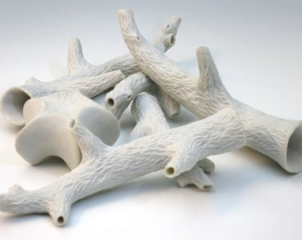 Faux bois, hand carved white porcelain twig