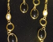 Vintage Park Lane Necklace and earrings. Gold Pierced with Black cabochon, Necklace has black and Faux Pearls