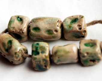 The clear body of spring -- a set of 7 rustic  ceramic art beads with leaves