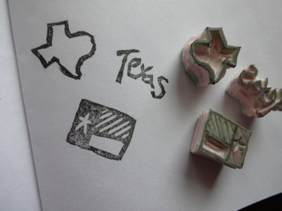 Set of tiny hand carved state pride stamps