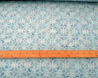 Winter White Blue with Silver Metallic premium cotton quilting fabric from Robert Kaufman - design 15926