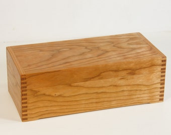 Long tea box crafted of colorful cherry wood