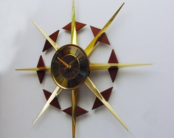 Starburst Clock by Elgin. Convertible Design Sunburst Clock with removable Walnut sliders.