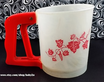 White, flour sifter with red ivy leaves and a red handle