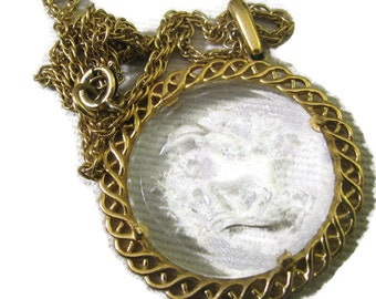Crown TRIFARI etched goat CAPRICORN lucite pendant on gold filigree plaque with chain.