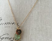 Gold chain with green pendant and R personalized