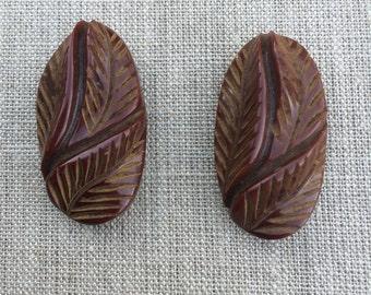 1930s  40s  carved bakelite dress clips