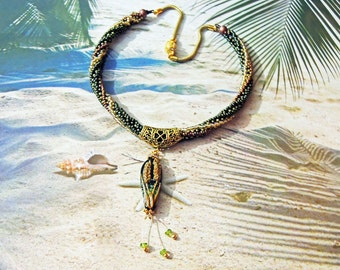 """Necklace """"The source of life wheat"""" hand spun RowanberryGlass pearl with faceted peridot stones"""