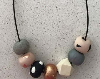 Pretty pastels and rose gold polymer clay necklace with hexagonal wooden bead