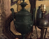 Green iron urn and lid. Grape leaves and grecian finial. Box.