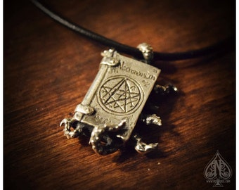 Necronomicon sterling silver book with tentacles pendant