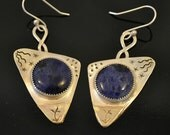 "Dark blue sodalite in sterling silver with brass accent.  ""Moonflower"""