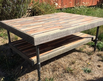 Beautiful barn wood coffee table with shelf in a mosaic pattern and featuring steel pipe legs