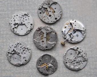 0.9 inch Set of 7 vintage wrist watch movements.
