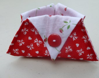 Red and white thread catcher with bows