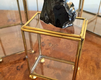 Glass trinket box with obsidian stone