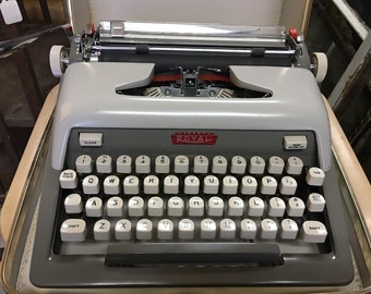 Vintage gray Royal typewriter with case and key