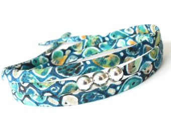 Popular hipster bracelet with silver focal beads, pretty gifts for girls, teal patterned Liberty fabric wrap, Uk jewellery  shop