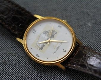 Vintage Semi truck quartz watch gold tone case and estes express lines on dial