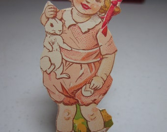 Vintage 1920's unused colorful  Dennison's die cut easter cut out of sweet toddler girl holding a rabbit and an eggshell