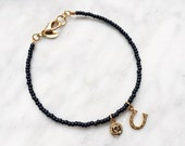 Gold horseshoe, black bead bracelet - good luck bracelet,horse shoe charm, lucky charm,seed bead bracelet,horse shoe pendant,good luck charm