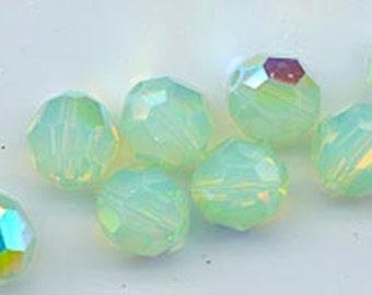 Twelve Swarovski crystals: art 5000 - 8 mm - chrysolite opal AB