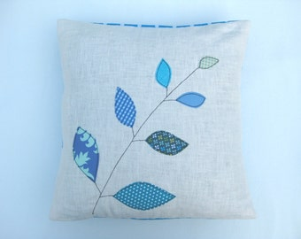 "Cushion cover, blue leaves on a branch, free motion applique, linen, cotton, 16"" / 40cm."