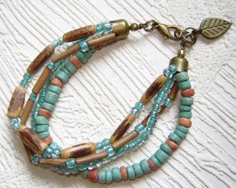 Turquoise  ceramic bracelet. Multistrand bracelet. Beadwork bracelet.