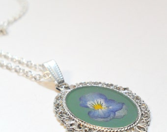 Wildflower Necklace, real pressed pansy flower on green enamel