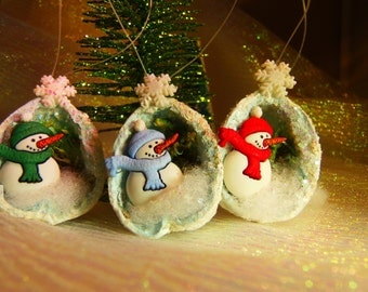 Miniature Snowman Ornament in a Walnut Shell You get a SET of 3 Snowmen - 1 Red, 1 Green and 1 Blue