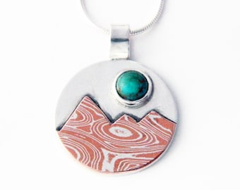 Mixed metal jewelry- mountain landscape jewelry mokume gane mountain and turquoise sun pendant