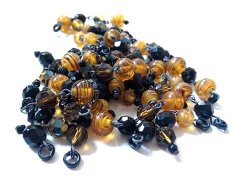 Vintage faceted Glass Beads - Amber & Black