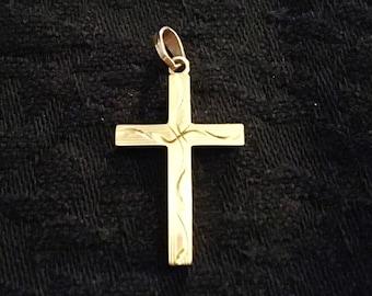 Gold cross.