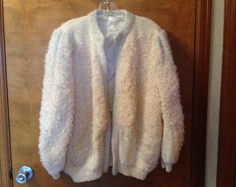 Hand knit wool sweater jacket.