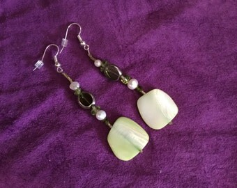 earrings made of antique beads  syvorski crystals and pearls in olive green
